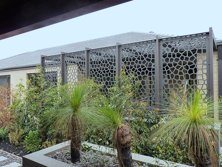 Enclose your patio to create shade, privacy, and added security with decorative screens. This is QAQ's 'Utah' design in painted compressed hardwood.  #decorativescreens #pergolascreens #securityscreens #qaqscreens
