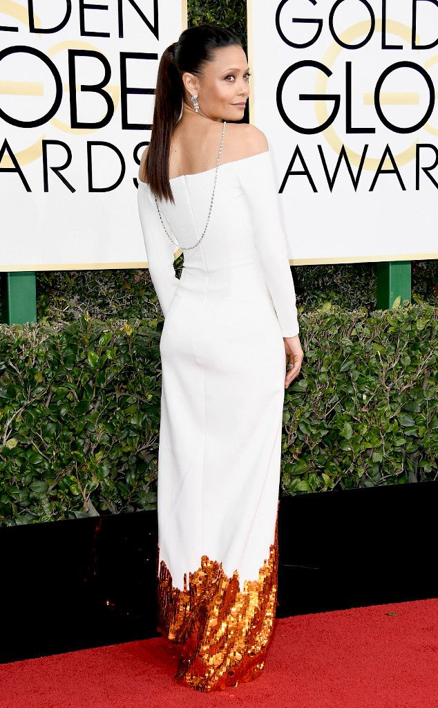 Thandie Newton from Best Dressed at Golden Globes 2017  The Westword star was on fire! The actress was a vision in white...and more. If the structural column dress and long, swooping necklace didn't impress you, the sequined detailing on the bottom of her dress will.