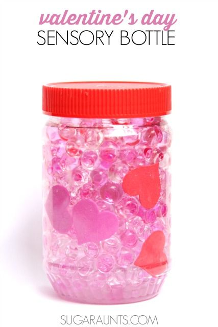 Valentine's Day waterbead heart sensory discovery bottle for calming sensory strategies and fine motor skills.