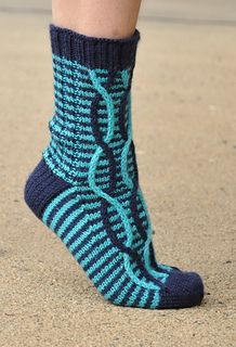 Beautiful two-coloured knitted socks with some spiral thingies at the front. All her patterns are free. Some of them are in English - these blue ones are in Finnish only, sorry, but there is an almost self-explanatory chart about how to make the pattern. Models are by Sari Suvanto.
