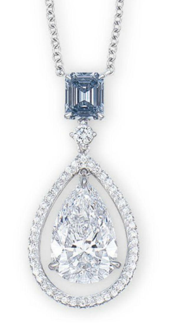 BLUE DIAMOND WEIGHING 0.56 CARAT SUSPENDING A PEAR-SHAPED DIAMOND WEIGHING 3.06 CARATS, WITHIN A BRILLIANT-CUT DIAMOND FRAME, SPACED BY A BRILLIANT-CUT DIAMOND, JOINED TO A COLLET-SET BRILLIANT-CUT DIAMOND FINE NECKCHAIN. <3