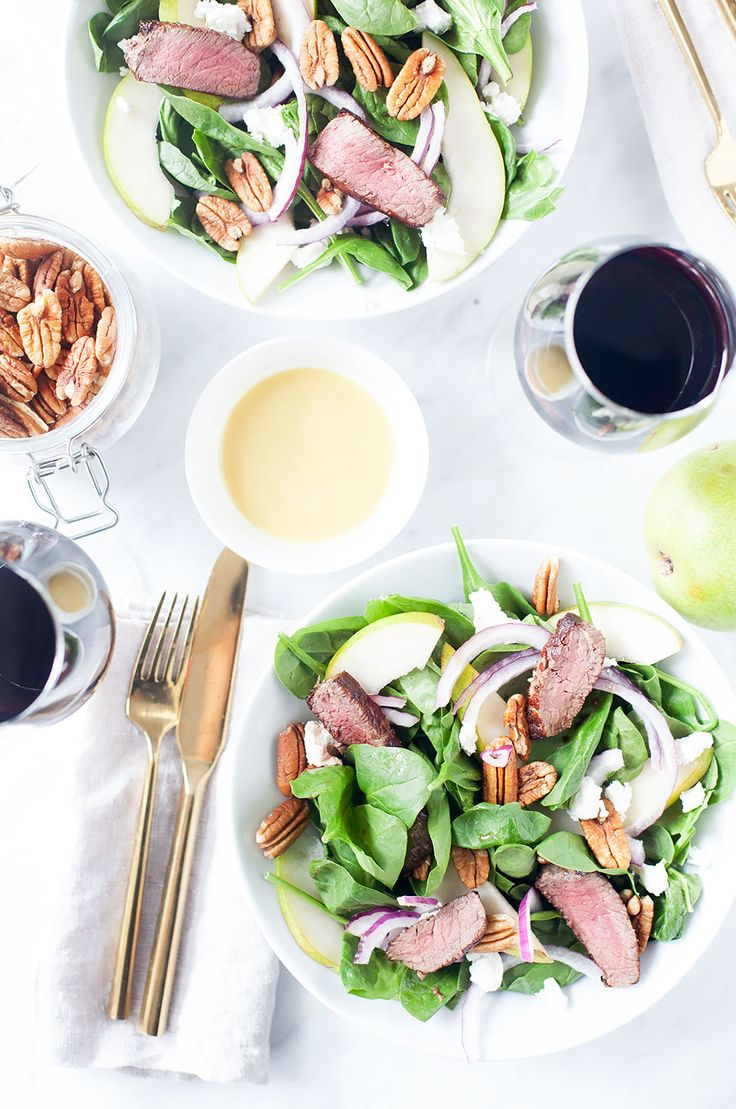 This spinach, pear, and goat cheese salad with steak (optional), is a simple and elegant dinner salad served with honey mustard. Gluten-free and paleo.