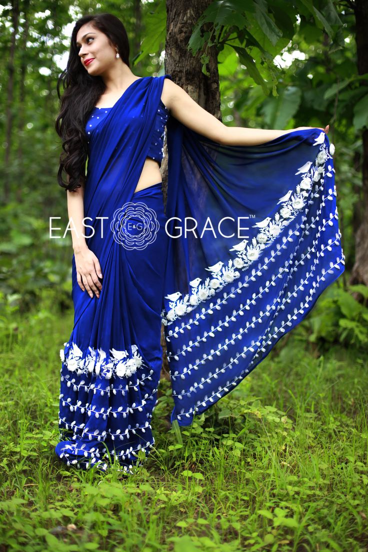 Featuring a rich navy blue pure silk chiffon saree with organza flowers and silken white birdies and beautiful vines with ribbonwork white leaves along the bottom. Here's a saree to invoke that feminine mystique in you. PRICE: INR 18,232.00; USD 268.12 To buy click here: https://www.eastandgrace.com/products/white-blue-birdies For help reach us at care@eastandgrace.com. With love www.eastandgrace.com