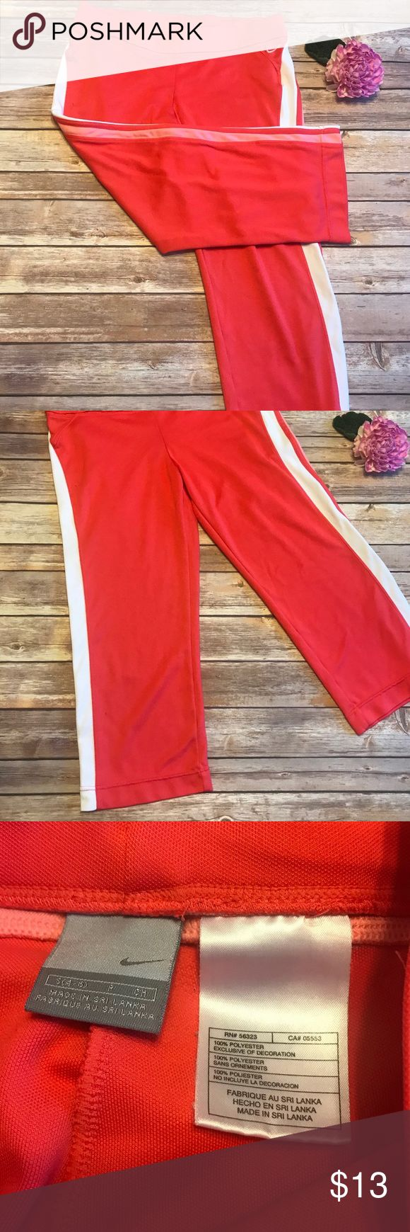 Nike coral Capri pants Nike coral Capri pants   ▪️ Measurements flat: length 30' waist 16'  inseam 23' rise 8.5 ▪️Condition: pre owned, some fraying/loose strings on waist band (noted on last 2pics) but over all great condition Nike Pants Track Pants & Joggers