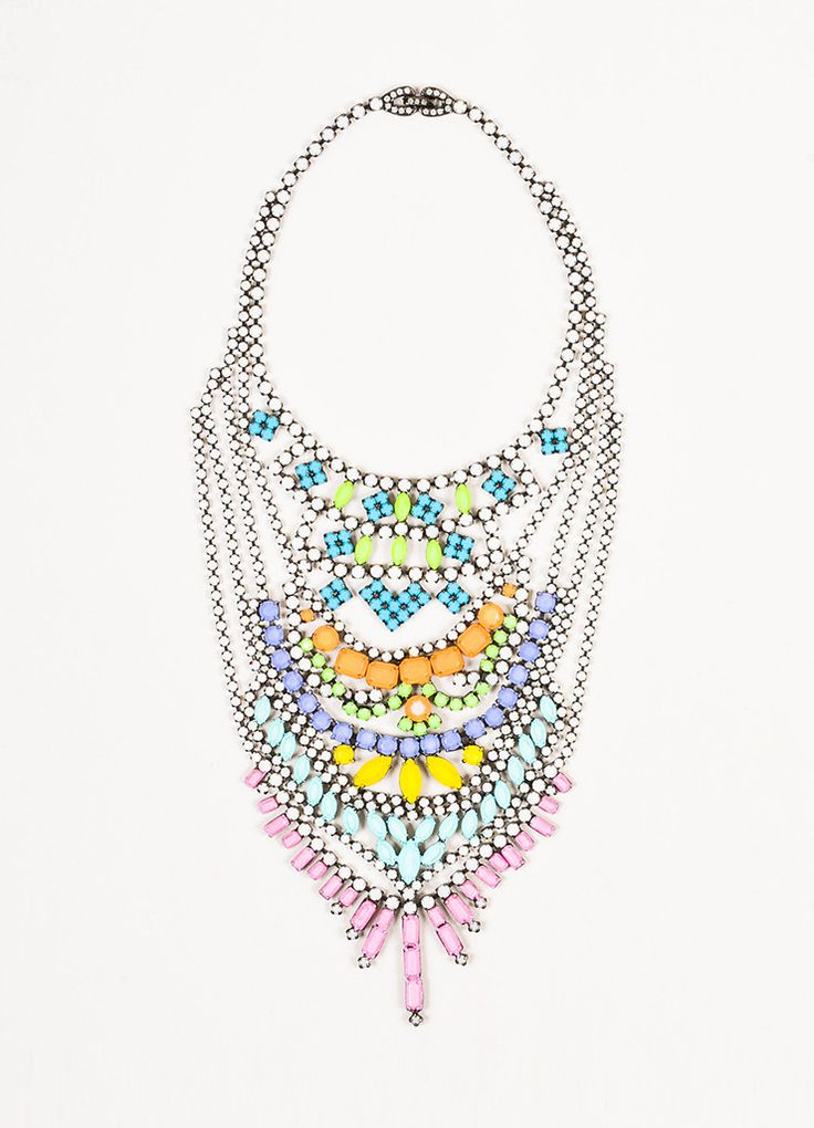 Known for its unique construction, this bold chandelier necklace from Tom Binns is perfect to make a statement to any outfit. Gunmetal toned metal base. Small round white translucent rhinestone embell