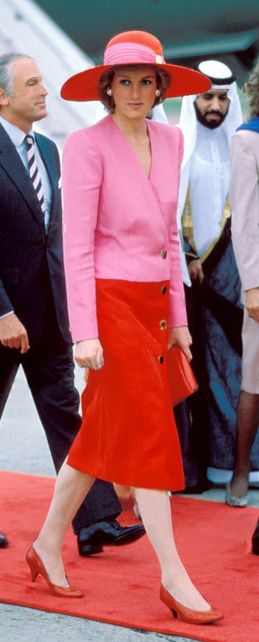 March 14, 1989: HRH Diana, Princess of Wales during her official tour of Kuwait. She is wearing a pink & red coat dress designed by Catherine Walker and a matching hat by Philip Sommerville.