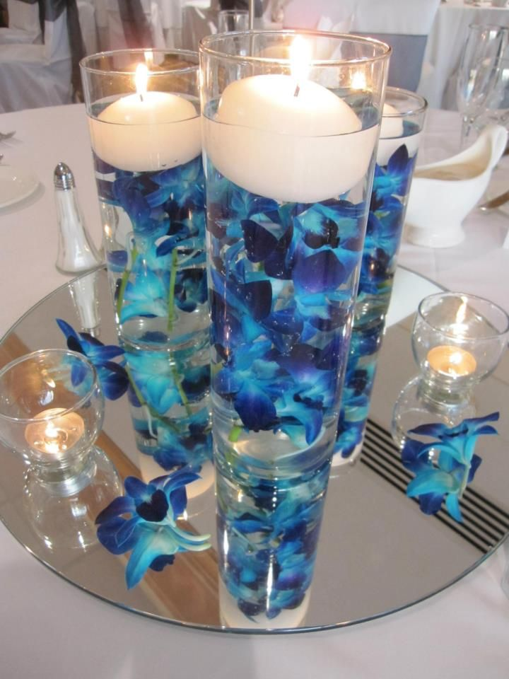 Blue orchid centerpiece the mirror at bottom