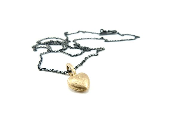 Gold heart with silver chain. By Little Raw Detail, Karina Bach-Lauritsen.