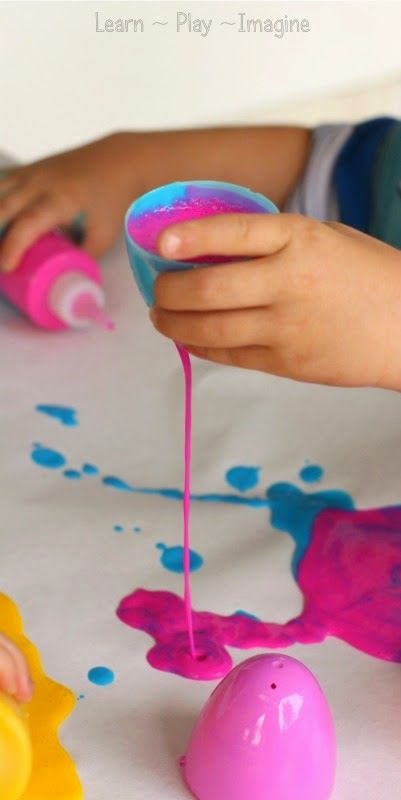 Drip painting with plastic Easter eggs - process art for preschoolers