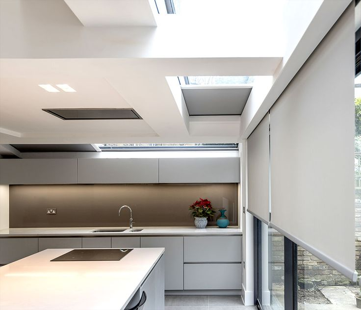 Concealed roller blinds in skylight and above sliding doors in London kitchen extension. All concealed in Blindspace boxes.     #Shades #Hidden #Blindspace