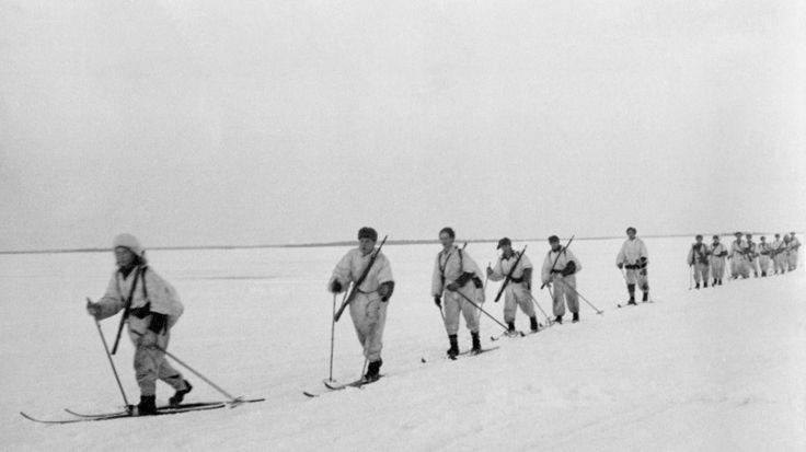 Division of Finnish skiers moving on the frozen lake