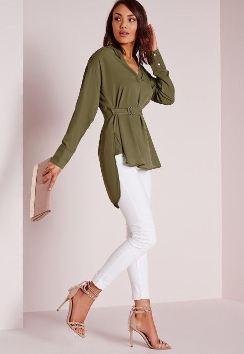 """Be a wrap star this season in this kick ass khaki D ring blouse. With its relaxed, loose fit and D ring belt fastening, wear with a midi skirt and thigh high boots for effortless style.  Approx length 82cm/32"""" (Based on a UK size 8 sample)..."""