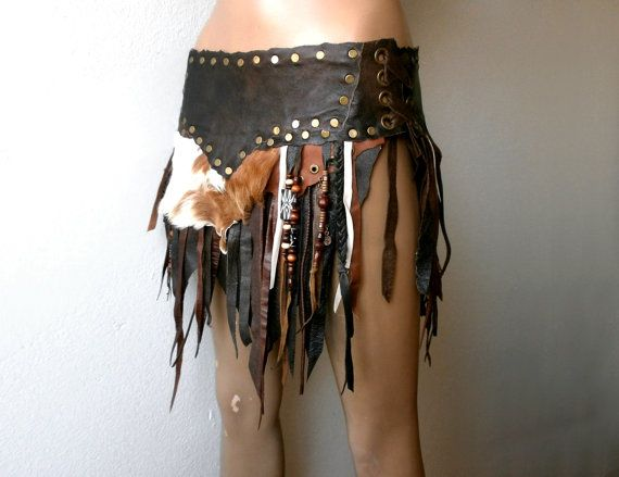 Skirt made out of different tones of brown real leather and tatters of real fur. Braids, fringes, wooden beads and antique brass color metal studs.