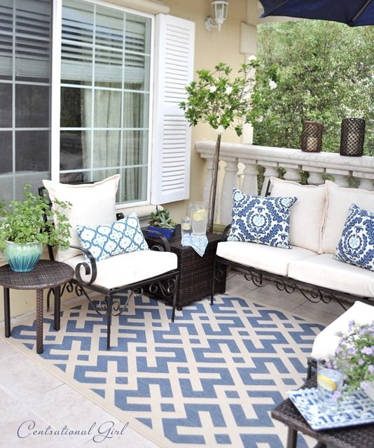 Use an outdoor rug to anchor backyard furniture and seating groups. It also adds another layer of color, pattern and texture to the overall design.