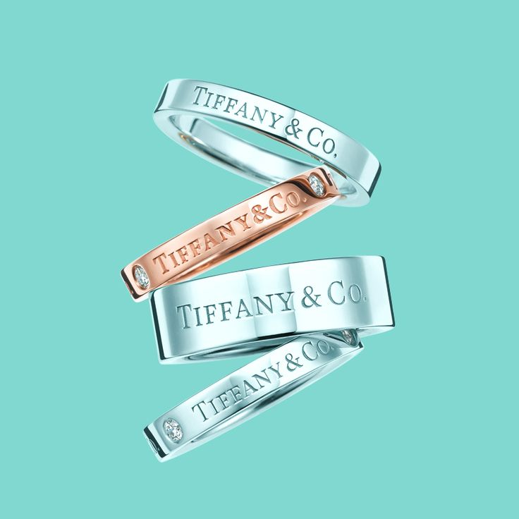 Tiffany & Co. band rings in platinum and 18k rose gold with and without diamonds. #TiffanyPinterest