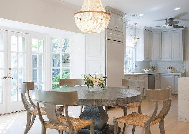 Dining Room And Kitchen. Kitchen Opens To Dining Room. Open Dining Room To  Kitchen Features A Round Zinc Dining Table Lined With Gray Klismos Chairs  ...