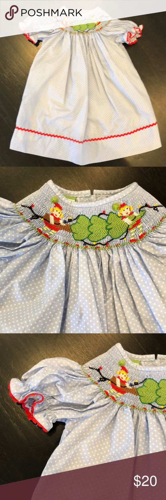 Girls 18mo Smocked Christmas Dress Girls 18mo Candyland smocked Christmas dress Smocked detailing of 2 elves carrying a Christmas tree and Christmas lights. 2 white buttons on back.  EUC-Only worn once. Candyland Dresses