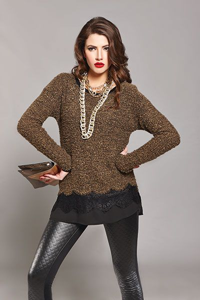 Prove you can be comfy and stylish wearing a basic pair of leather leggings and a long olive blouse!