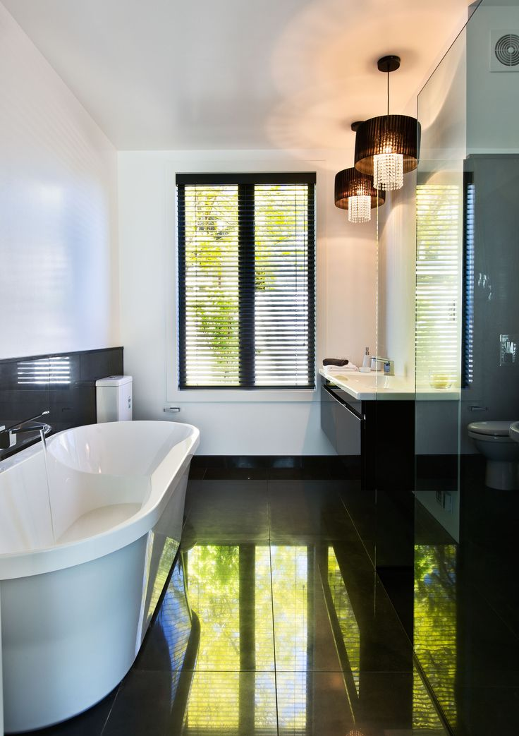 This ensuite bathroom includes a bath and is truly a place to unwind.