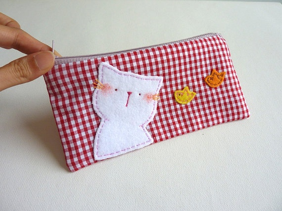 Look at that sweet little felt face and those darling little birds on this zippered case.