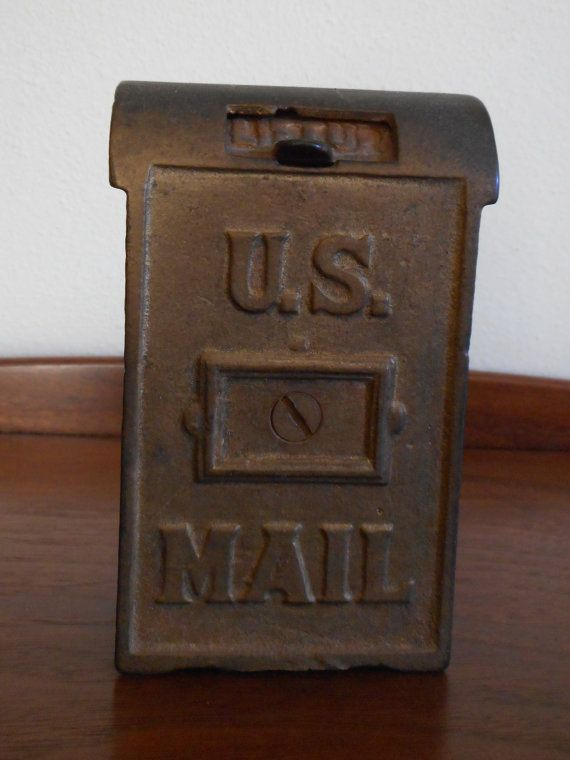 A.C. Williams Mail Box Bank #4948½ as listed in their 1912 Catalog page 97. This penny bank is cast iron finished in bronze. It is in really nice