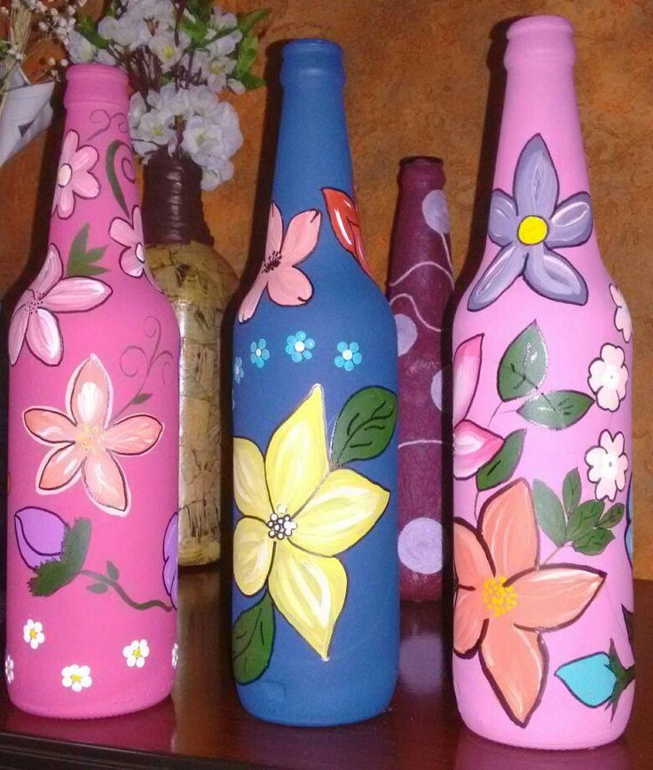 Garrafa decorada flor de chita.