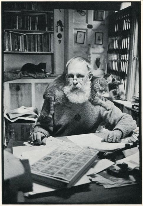 American writer and illustrator Edward Gorey, known for his macabre illustrated books, with cat