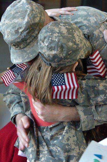 A soldier from the Virginia National Guard hugs his daughter after returning home from a deployment. Virginia National Guard Soldiers returned home in mid-December after serving in Iraq since August 2011. (National Guard Photo by SFC A.J. Coyne)