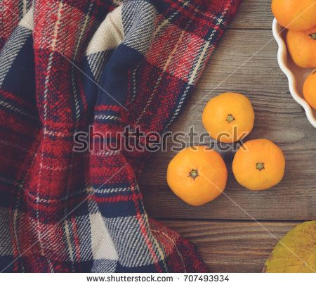 Flat lay view of fresh mandarines on wooden table and bowl - Autumn concept