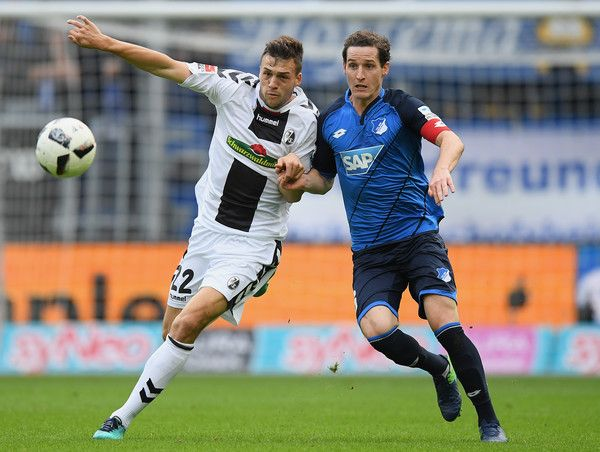 Sebastian Rudy Photos Photos - Jonas Meffert of Freiburg and Sebastian Rudy of Hoffenheim compete for the ball during the Bundesliga match between TSG 1899 Hoffenheim and SC Freiburg at Wirsol Rhein-Neckar-Arena on October 15, 2016 in Sinsheim, Germany. - TSG 1899 Hoffenheim v SC Freiburg - Bundesliga