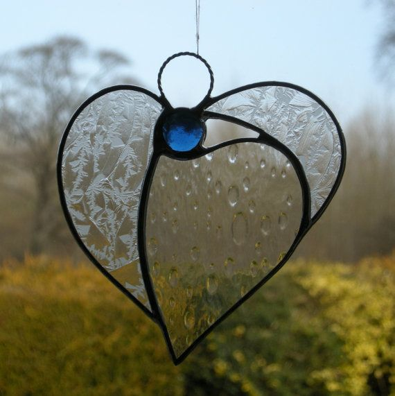 This beautiful stained glass abstract designed hanging window ornament (Angel Heart) has been handcrafted and designed by myself using the traditional copper foiling method (no stick on lead or glass film). The design is effective with the glass colours (textured clear glass heart with a different textured glass wings) and textures of the glass used. A glass glob (cobalt blue) forms the head of the Angel Heart.    The soldering is then polished to give a silver finishing effect. I have taken…