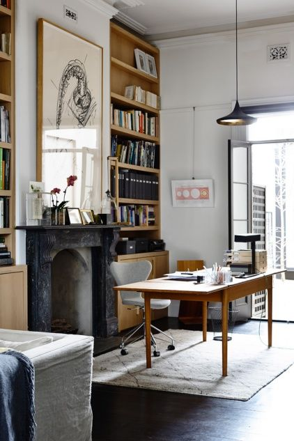 Study- Desk in front of black fireplace flanked by floor to ceiling bookshelves. Gorgeous!