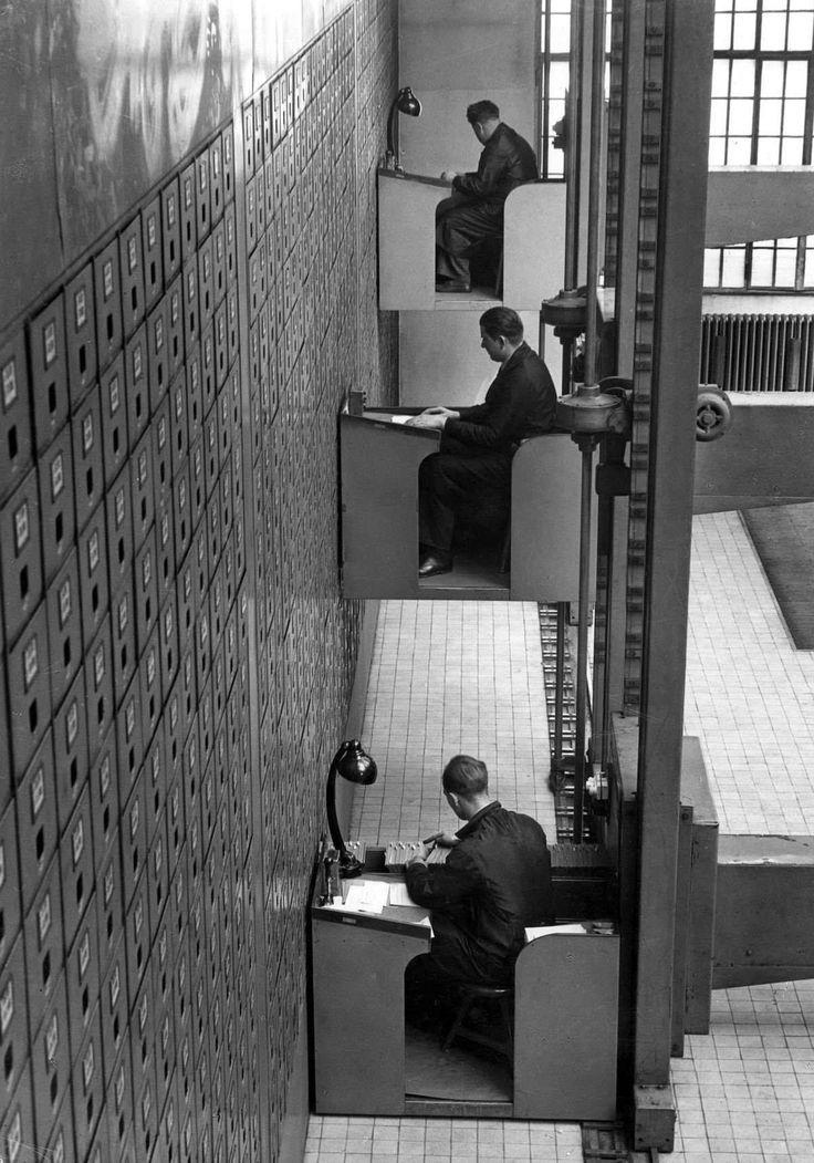 1937 France - elevator desks at an archive.