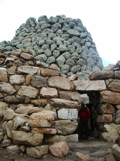 Tower and enclosure of the Nuraghe in the ancient and deserted village of Ruinas, inner Sardinia.This place is really isolated among the mountains and the wilderness, and it is fascinating to think that it was inhabited from Bronze age to the early Middle Ages