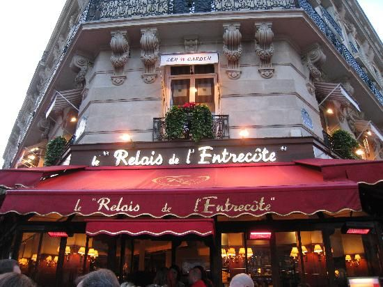 Relais de l'entrecote Paris.  The menu - Steak with special sauce, fries and wine. That's it!  Worth standing in line for.