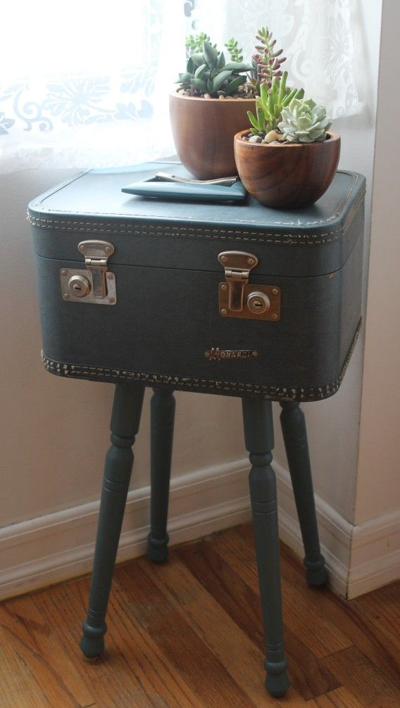 Vintage hardcover suitcase makes a great table with hidden storage!