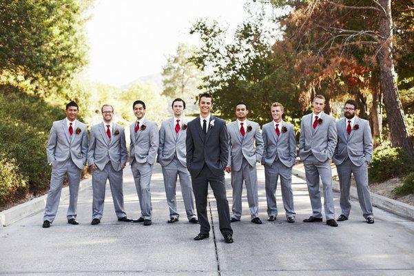 Groom wears black while his groom men wear charcoal