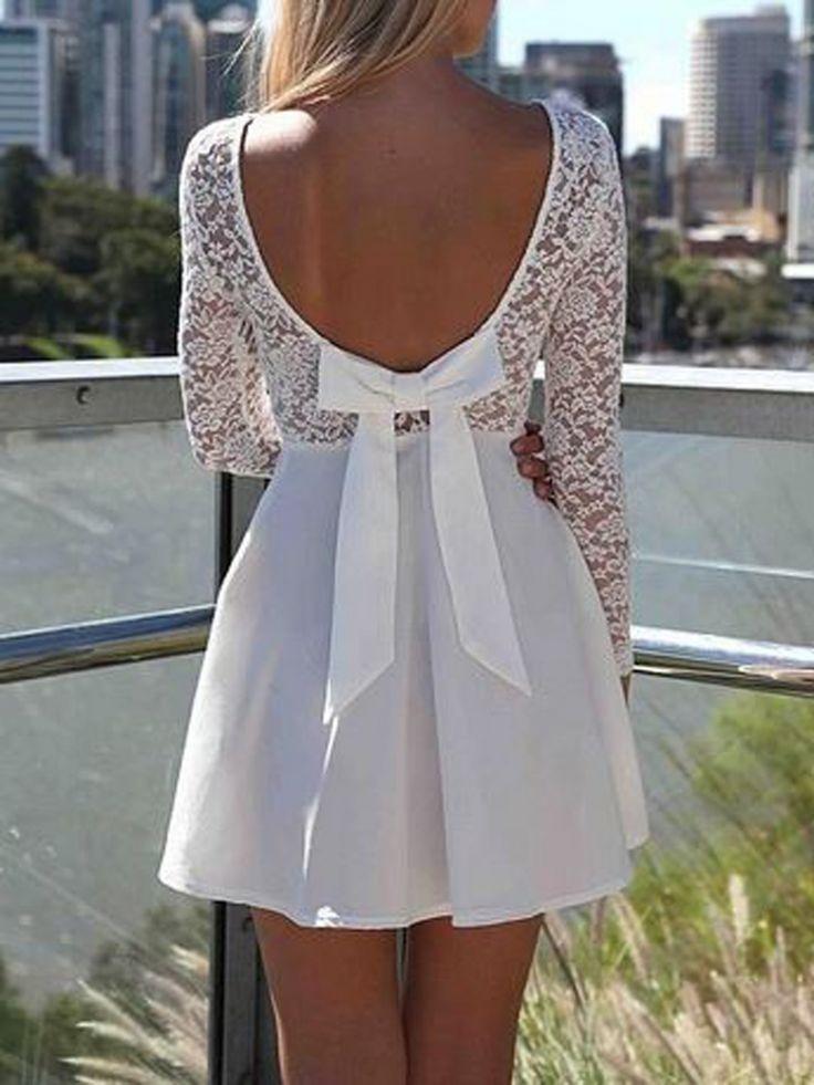 jurk met zomers gevoel vanachter een open stuk met een mooie grote strik