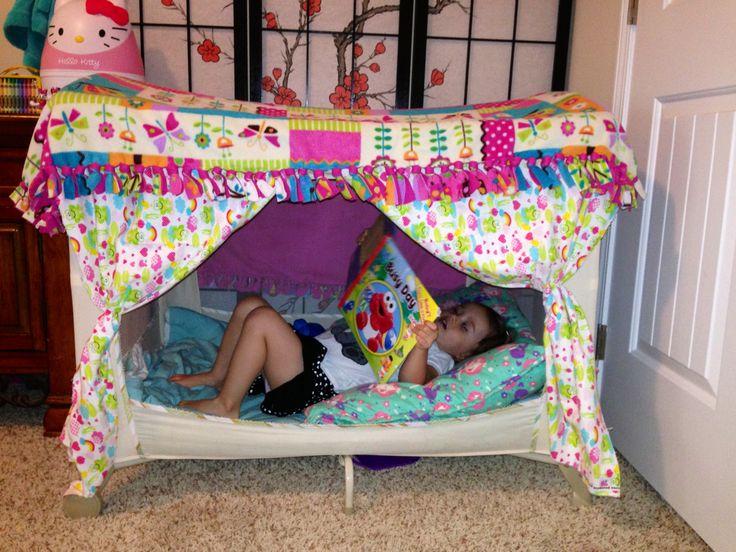 Our repurposed pack n play playpen. Reading tent.
