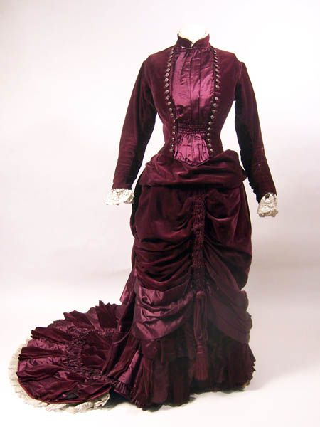 Dark red velvet and silk satin. Two piece. Edged with piping. c.1880-82.