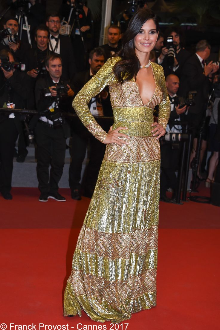 The gorgeous Rica Oliveira showing her showing her divine dress to the photographers  #franckprovost #frenchtouch #beauty #redcarpet #cannesforever #cannes2017