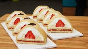 Gåsebryst - traditional Danish cake with sponge, jam, creme anglaise and cream covered in a thin layer of marcipan