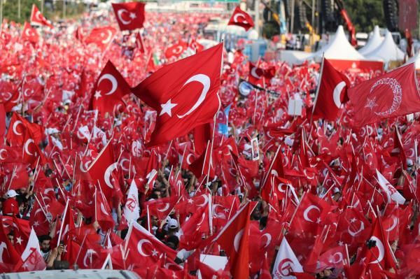 Turkey marked the one-year anniversary of a failed military coup by firing about 7,400 police, soldiers and other public servants on…
