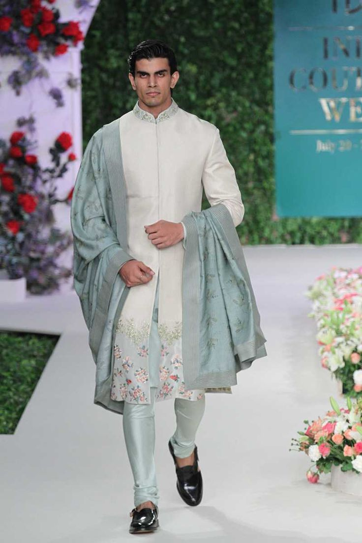 Simple and sober, this greyish white floral sherwani is a total hit. Vintage Garden by Varun Bahl #frugal2fab