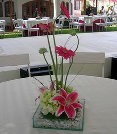 arreglos florales para boda2.....for lots of tables and a small budget to do the flowers.....
