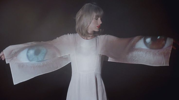"""Taylor Swift's """"Style"""" Video Is Full of Romantic White Dresses: Taylor Swift can transition from a crop top to a full, feminine dress in an instant —and she never takes off her red lipstick."""