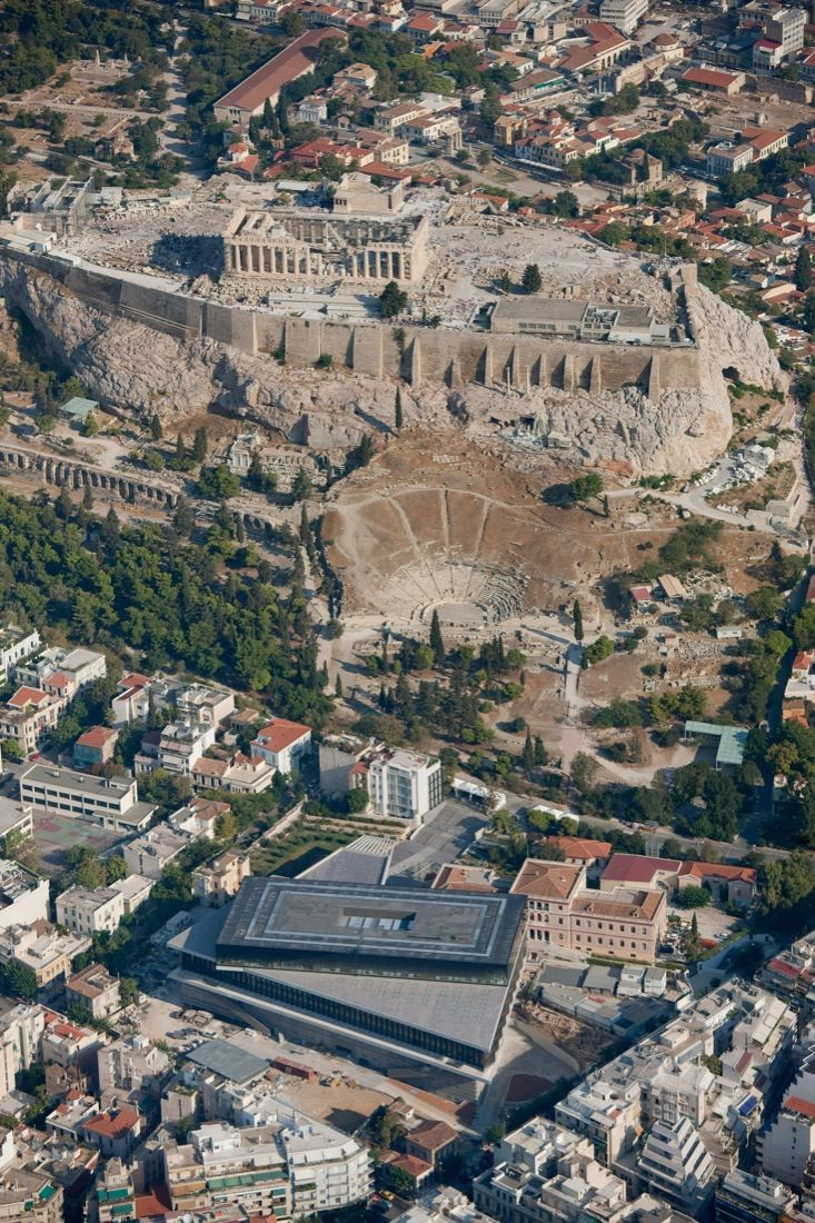 View of the Acropolis with the Parthenon and the new Acropolis Museum below, Athens, Greece.