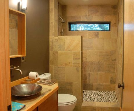 Small Bathroom Idea with Semi-Open Shower and Glass Door and Brown Wall Tile Combined Blue Wall Paint Color and Dark Floor Tiles also Single Vanity Sink and Frameless Mirror and Flush Toilet and Towel Rack and Beautiful Flowers : Pennyroach