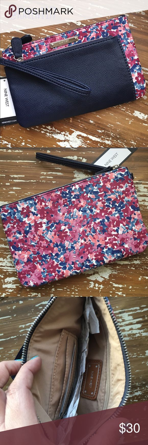 """Just InNine West Floral Misty Double Wristlet NEW Ready for Spring Nine West Double Wristlet Clutch. Navy Blue color with Purple, Pink & wines hues. Faux leather exterior, color-block detailing, zip top closures, wristlet loop. Fabric interior lining, interior zip pockets and card slots. 8 1/2"""" L x 5 1/4"""" H x 1/2"""" W Nine West Bags Clutches & Wristlets"""