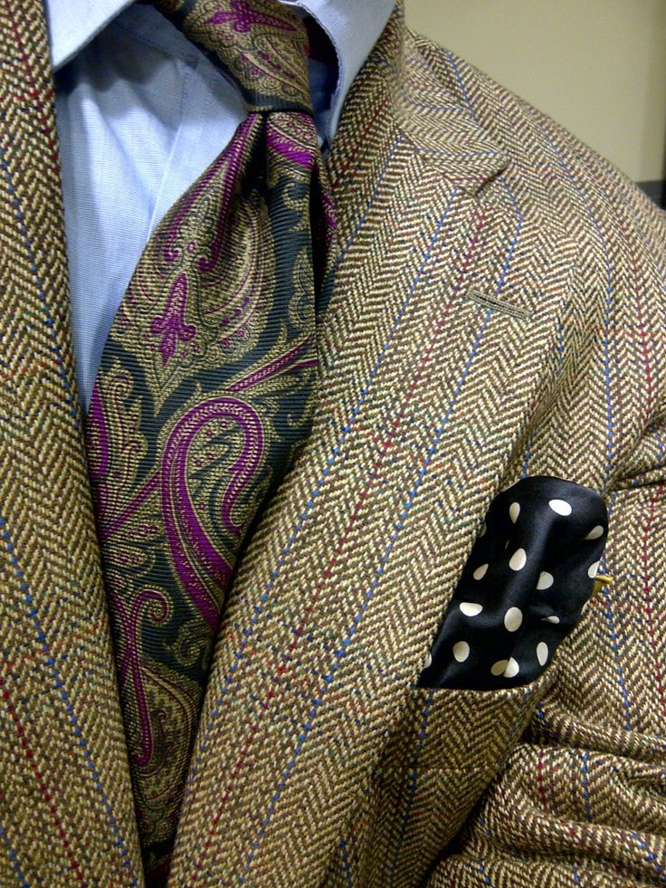the purple black and brown paisley is so awesome with the blue shirt and subtle pinstriping in the brown suit.